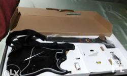Wireless PS2 Guitar hero for sale. RFS: PS console no