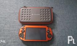 ps vita with hard red casing