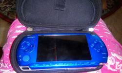 PSP 3006 16gb with games Pouch and charger Reason for