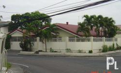 A commercial/residential corner lot along Pacita Ave,