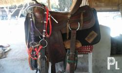 Second hand western type saddle,ready to use,complete