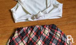 Includes 1 tie-front vest and 1 plaid skirt with