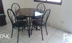 Selling a dining glass table with 4 chairs. Cash basis