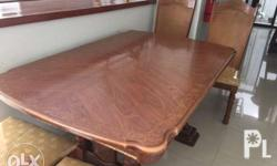 Six-seater dining table with 2 arm chairs and 4 regular