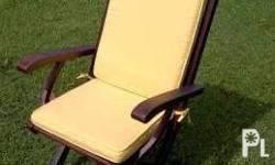 4 foldable chairs in teak wood. 1 with armrests and 3