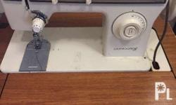 Brand: Singer Motorized sewing machine Used