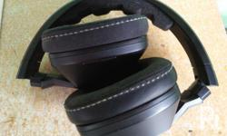 �Bare Headphones only w/ battery �Very Good