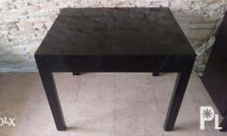 Small massive table made from good wood, shiny black