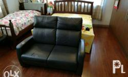 Black leatherette 2-seater sofa. Bought 2010, with a