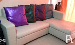L shape Sofa for sale, with four colored pillows..