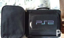 Slightly used PS2 slim play station w/ games and