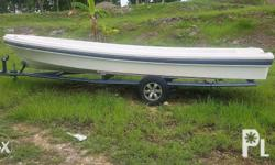 Open speed boat, 23 feet with galvanized trailer,