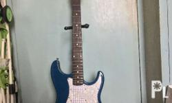 Stratocaster metallic blue color with white pearloid