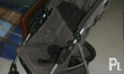 gray/black combination- Kolcraft brand stroller from