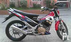 Deskripsiyon I'm selling my suzuki raider 150 red 2006
