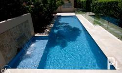 This fully-tiled lap pool benefits from a maximum