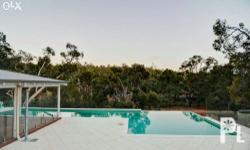 This infinity edge lap pool overlooks a beautiful