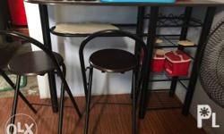 Slightly used long wine table with 2 folding chairs.