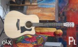 4 month old custom acoustic guitar. -Real solid spruce