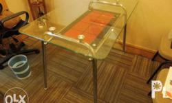 This beautiful glass designer table was purchased from