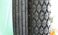 Slightly used front and rear tires including rim and