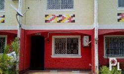 2br unfurnished townhouse with service area and garage.
