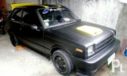 Description for sale is a toyota Starlet 2-dr. Year
