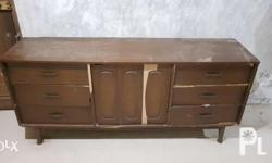 Very sturdy and long tv rack with drawers. Still