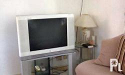 "A 27"" JVC white television set with tv stand and glass"