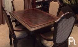 US Embassy dining table and hand carved four chairs.