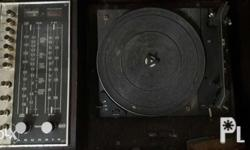 Vintage turntable with stereo. No longer functioning na