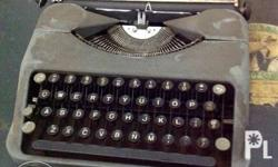 vintage from the 50s Hermes Rocket Portable Typewriter