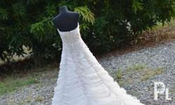 Elegant slightly used wedding dress with topper
