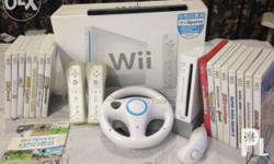 Wii Console 2 controllers with case 1 Nunchuk 1 wheel