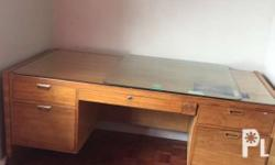 Wooden office table with glass top