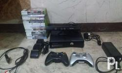 Xbox 360 (package) 18 cd's 2 controllers 1 charger 1